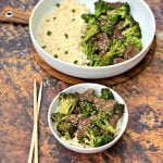 keto beef and broccoli in a white bowl with chopsticks