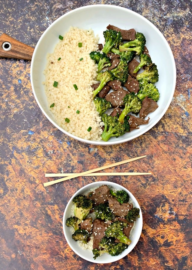 keto beef and broccoli with cauliflower rice in a white bowl