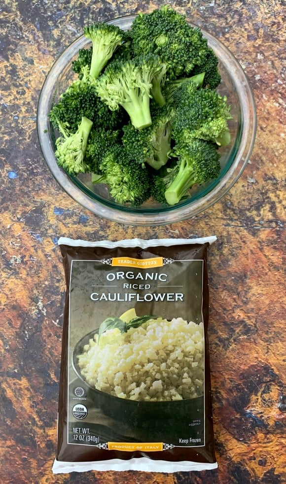 fresh broccoli in a bowl and a bag of frozen riced cauliflower