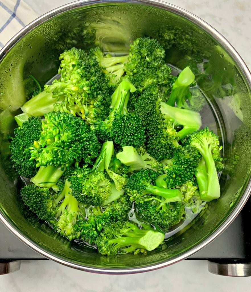 steamed broccoli with water in a saucepan