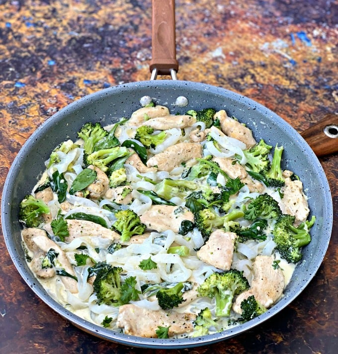 keto chicken alfredo with broccoli and spinach in a skillet