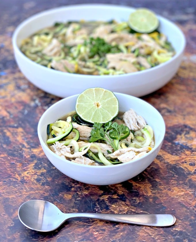 keto low carb chicken noodle soup with zucchini noodles in white bowls