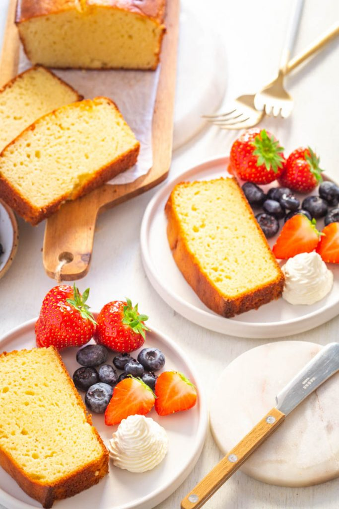 keto pound cake on a plate with berries