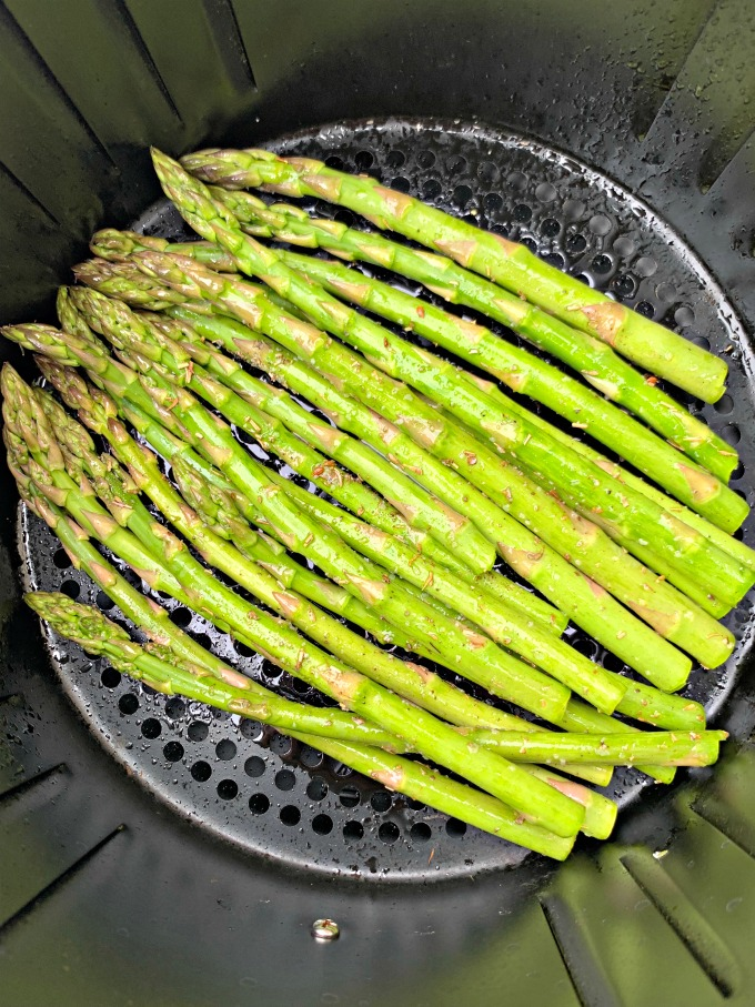 raw asparagus in an air fryer