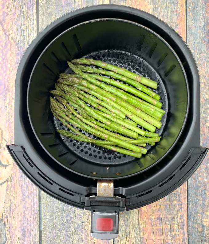 raw asparagus in an air fryer