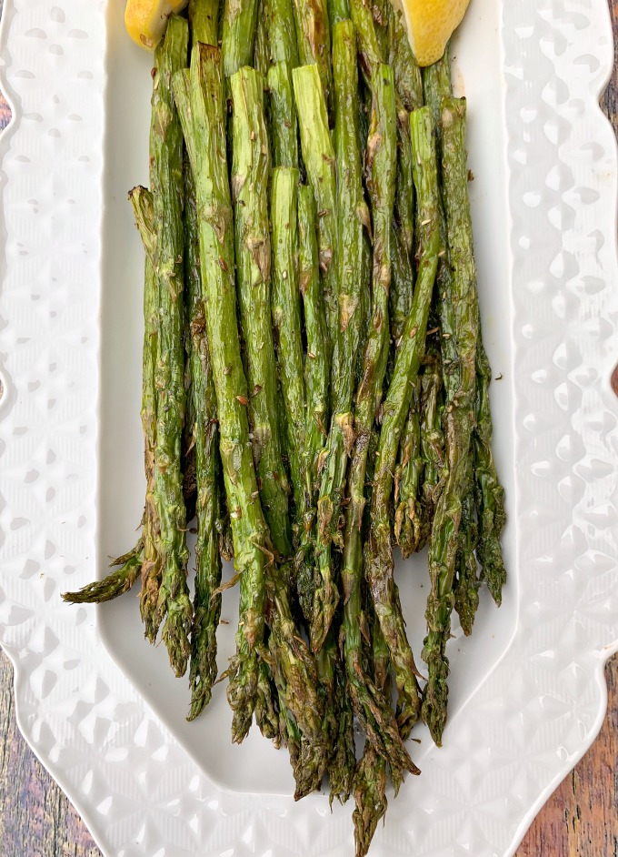 air fryer roasted asparagus on a white plate