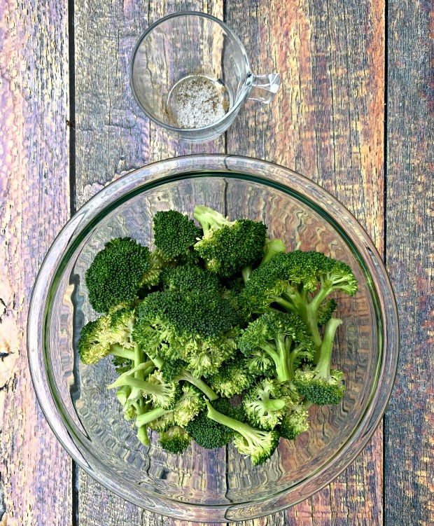 raw and cut broccoli in a glass bowl