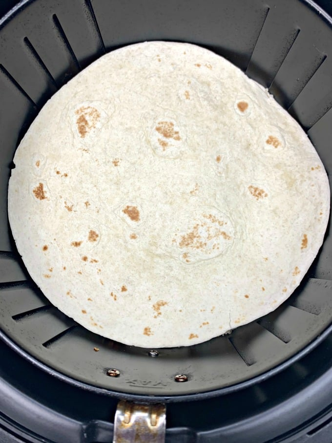 air fryer chicken quesadillas inside an air fryer