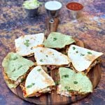 air fryer chicken quesadillas on a brown board