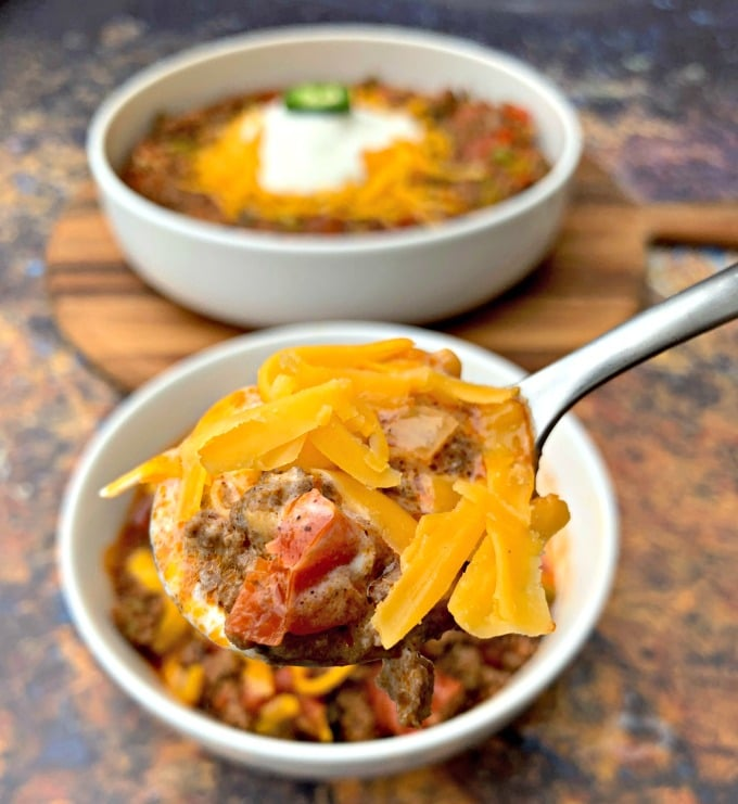 spoonful of keto beef chili with shredded cheese