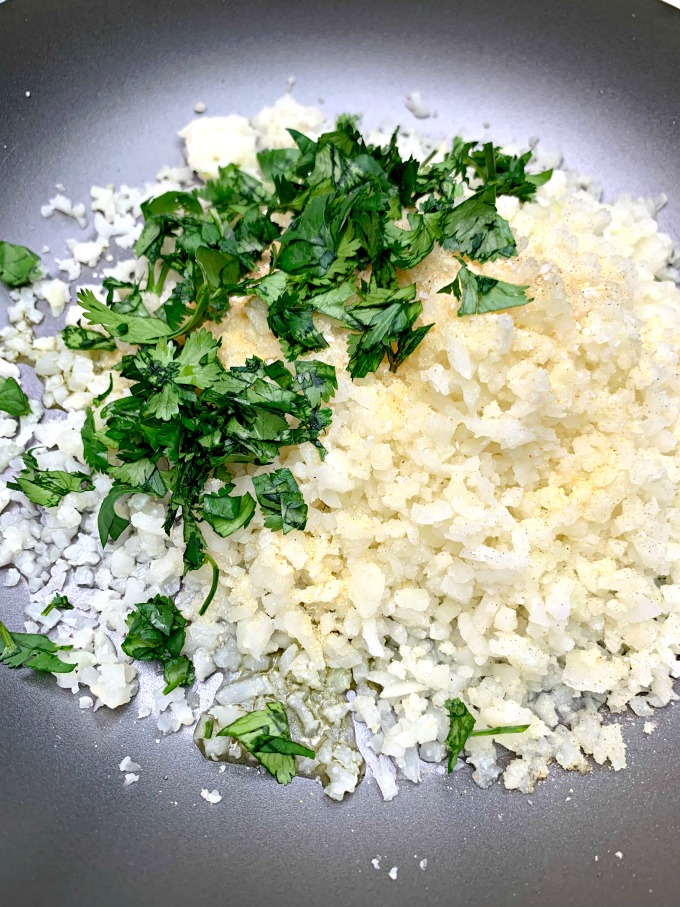 riced cauliflower and cilantro in a skillet