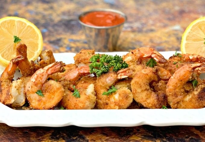 keto low carb breaded shrimp on a white plate