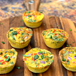 keto low carb air fryer egg bites cups on a brown plate