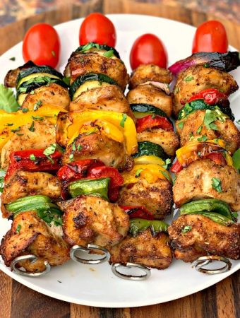 air fryer grilled chicken kebobs on a white plate