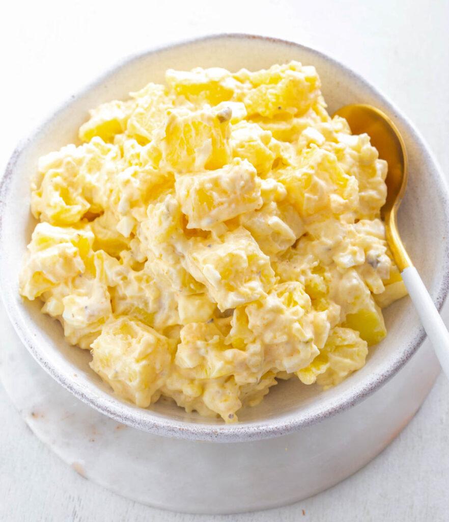 Instant Pot potato salad in a white bowl