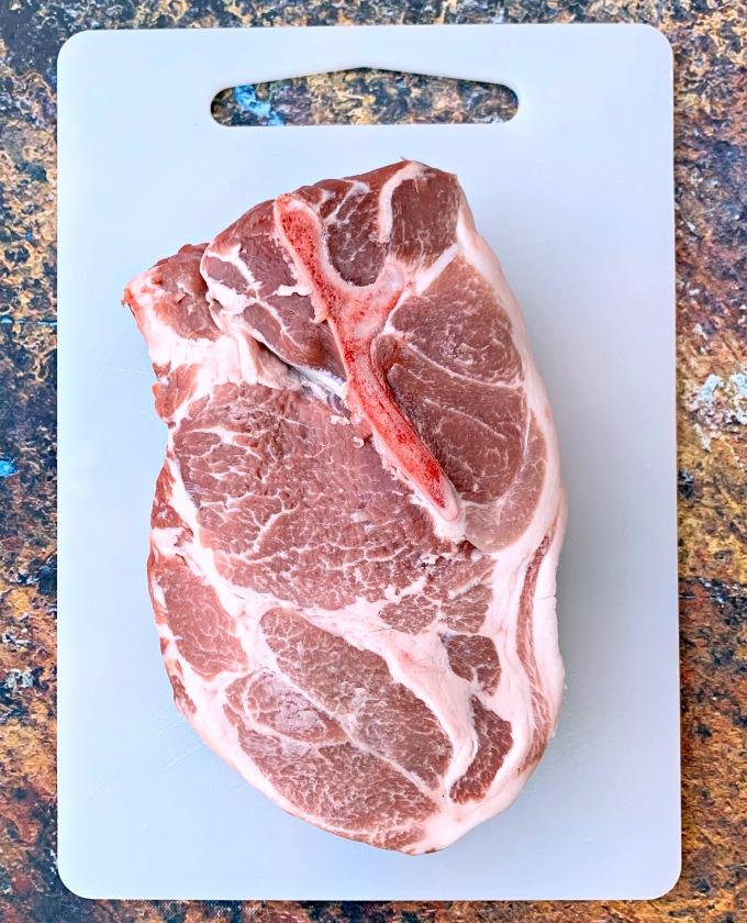 raw pork shoulder butt on a cutting board
