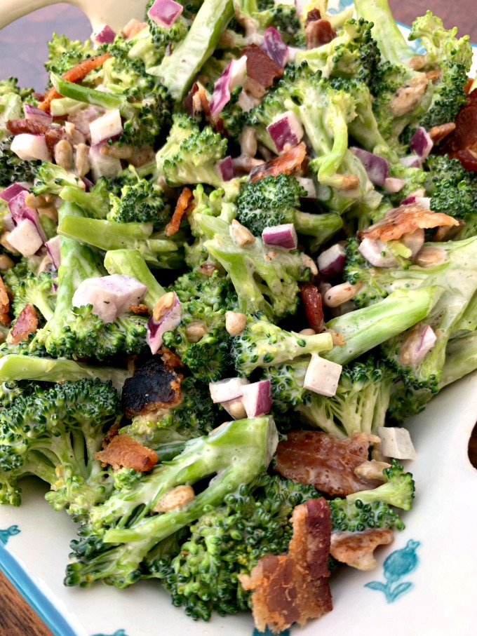 chopped broccoli with mayo, red onions, sunflower seeds, bacon, and sweetener