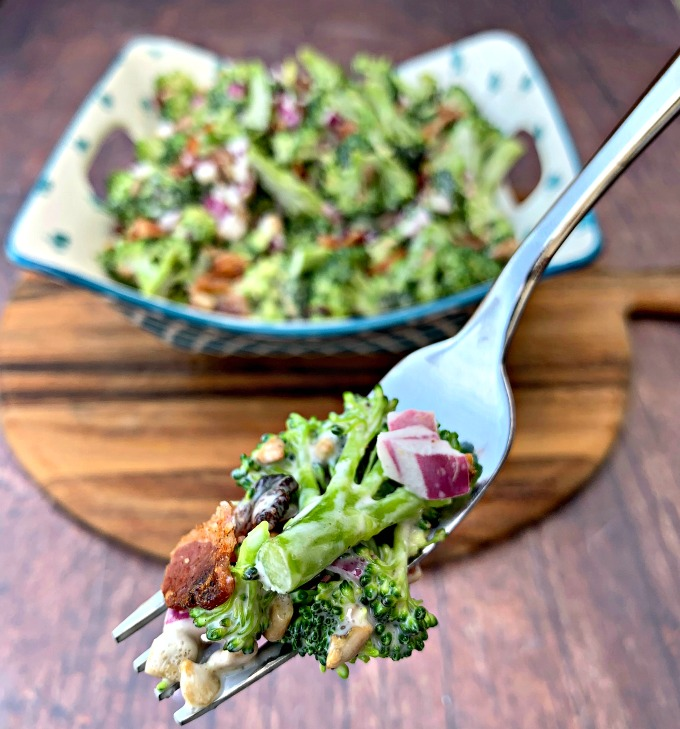 keto low carb broccoli salad with bacon held on a forkr