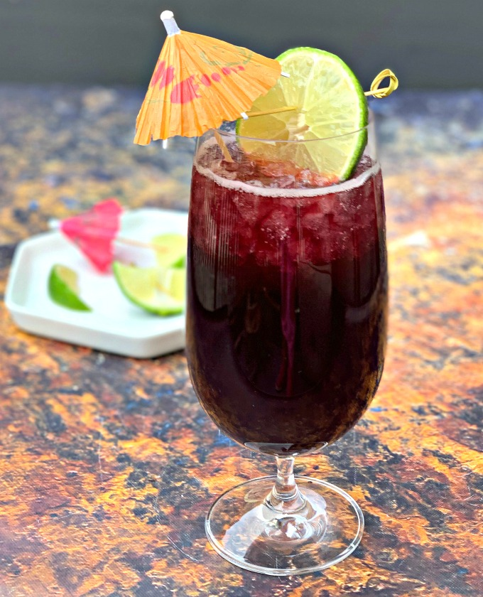keto low carb red wine sangria in a wine glass with a lime