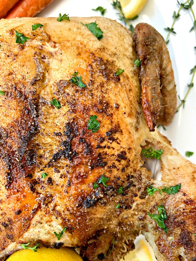 air fryer whole chicken on a white plate
