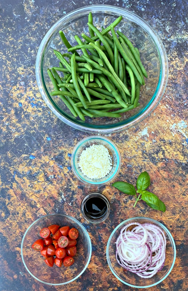 ingredients for cold green bean salad with tomatoes and feta cheese