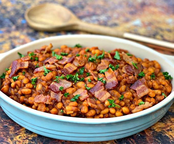 instant pot baked beans with bacon in a blue bowl