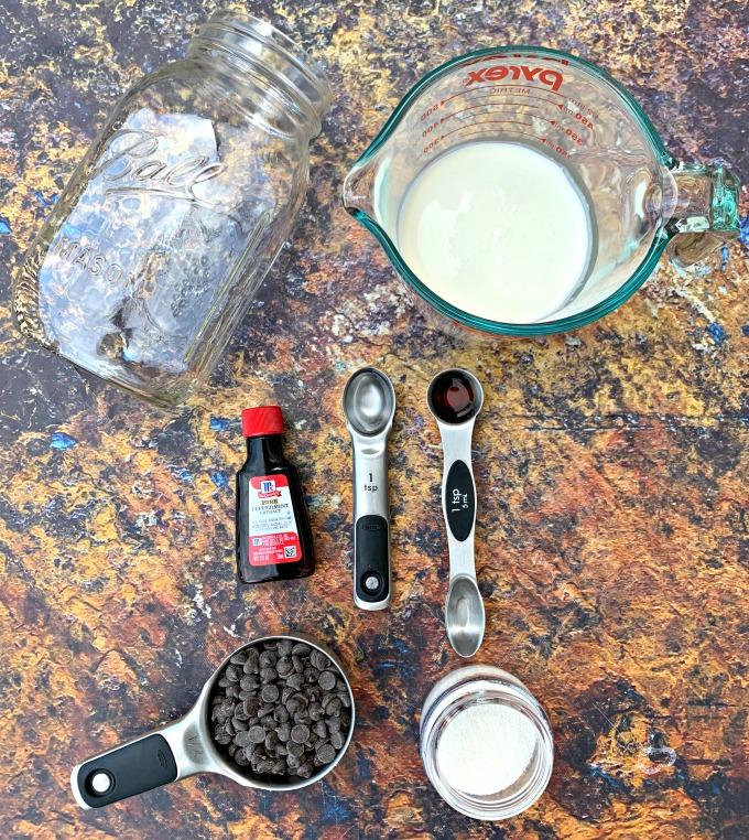 mason jar, heavy whipping cream, chocolate chips, sweetener, and vanilla for keto ice cream