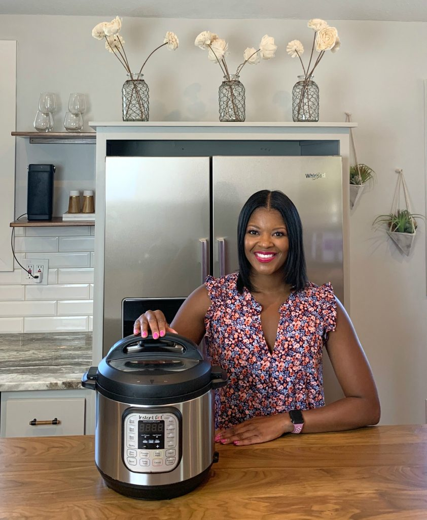 Brandi Crawford with an Instant Pot in a kitchen