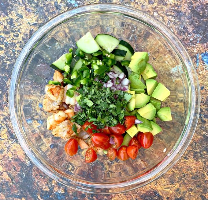 keto low carb shrimp avocado ceviche salad in a glass bowl