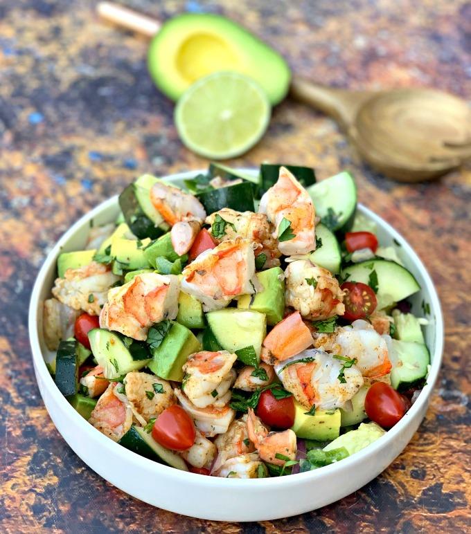keto low carb shrimp avocado ceviche salad in a white bowl