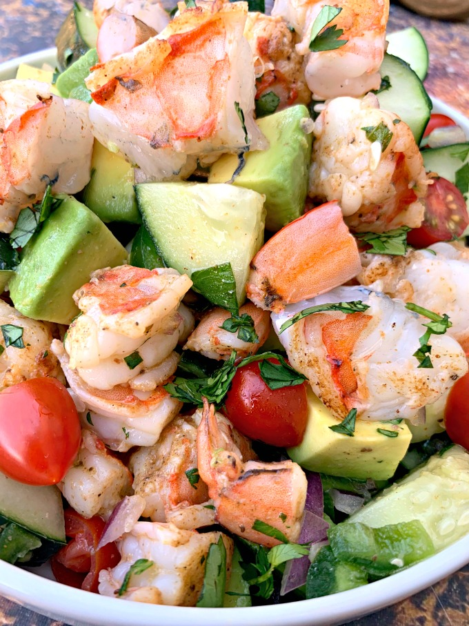 close up photo of keto low carb shrimp avocado ceviche salad in a white bowl
