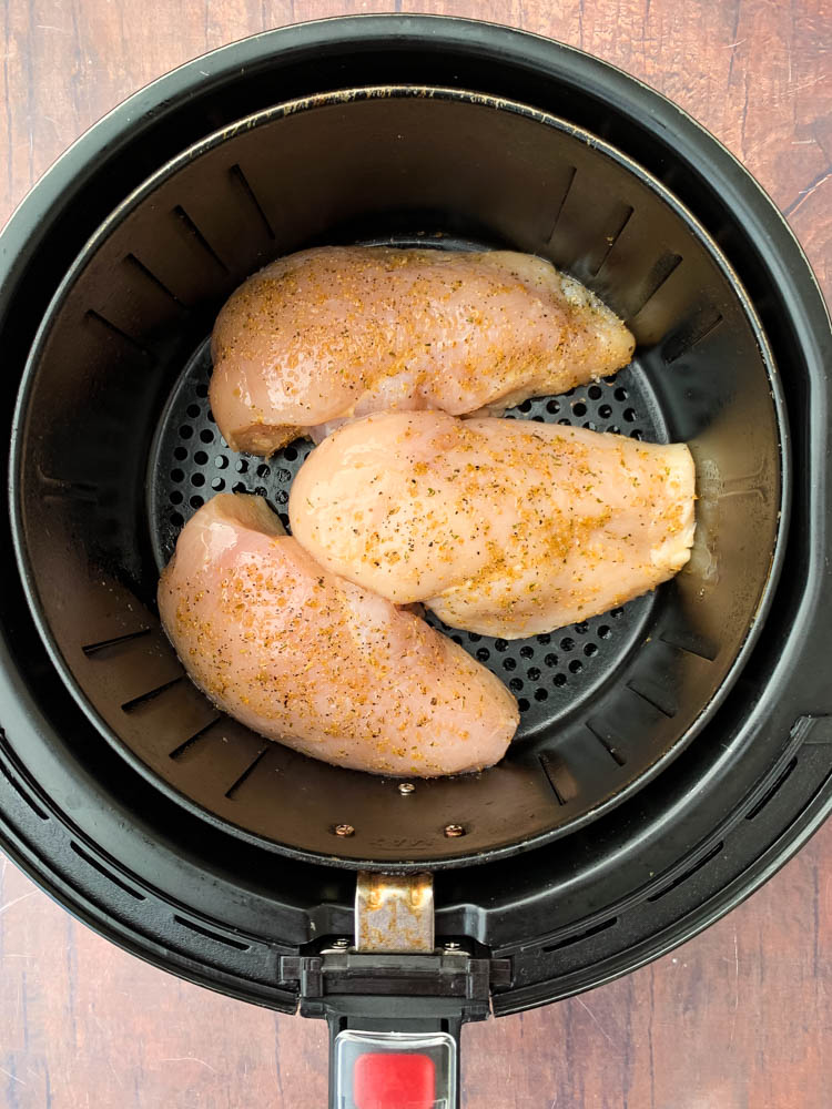 raw chicken breasts in an air fryer