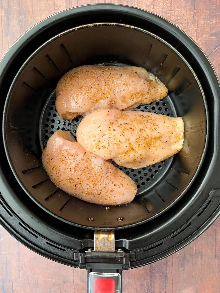raw chicken breasts in an air fryer