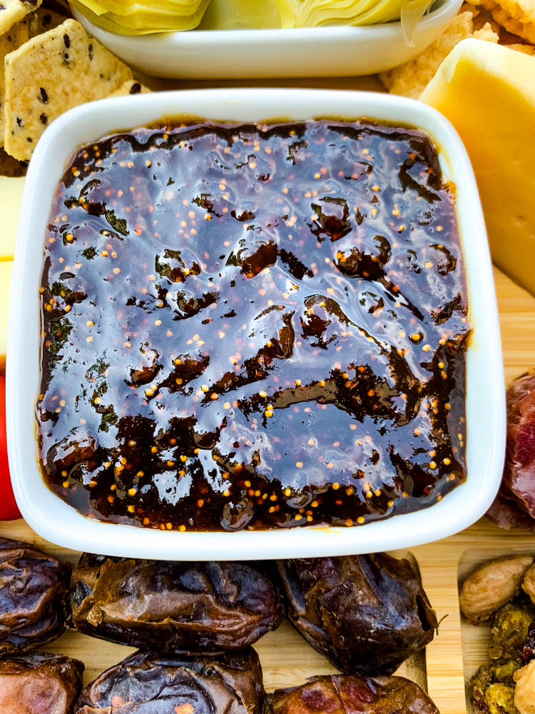 close up photo of fig spread in a bowl on a charcuterie board