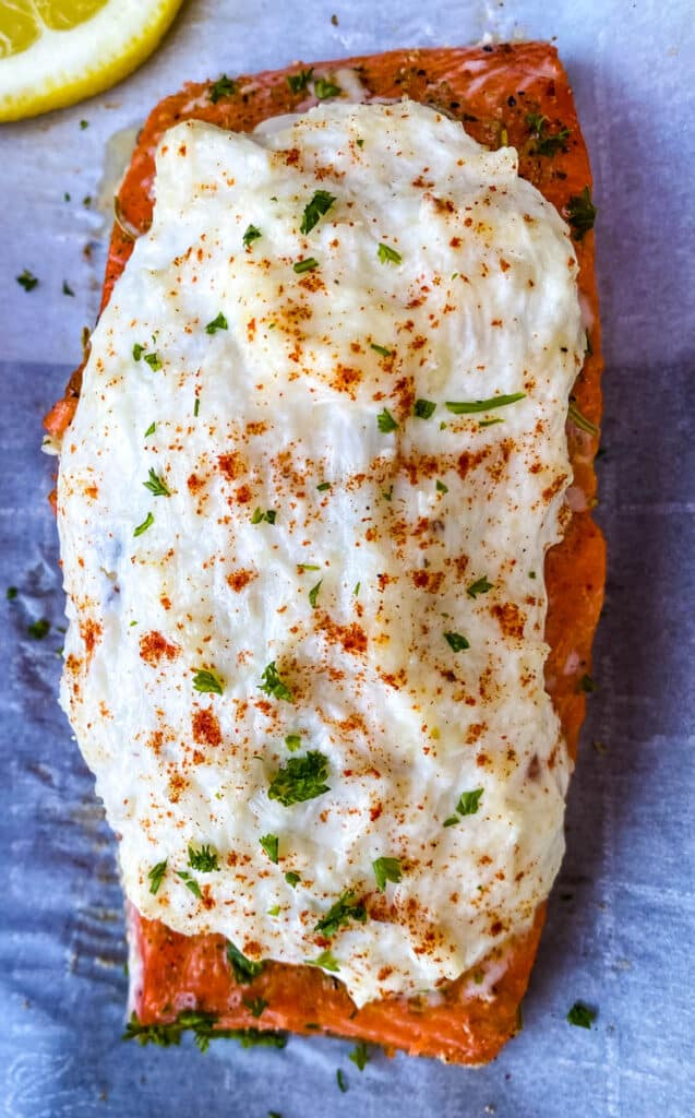 crab stuffed salmon on parchment paper