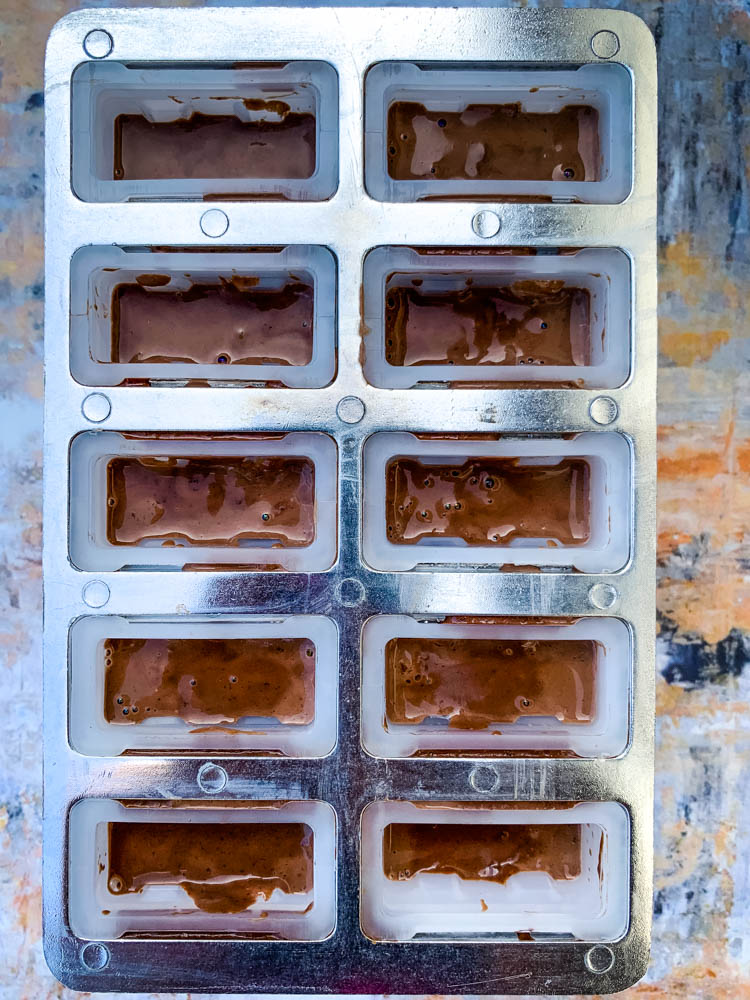 keto fudge popsicle mix in a popsicle mold