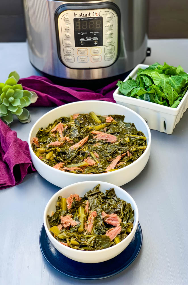 instant pot collard greens in white bowls with smoked turkey with an Instant Pot in back