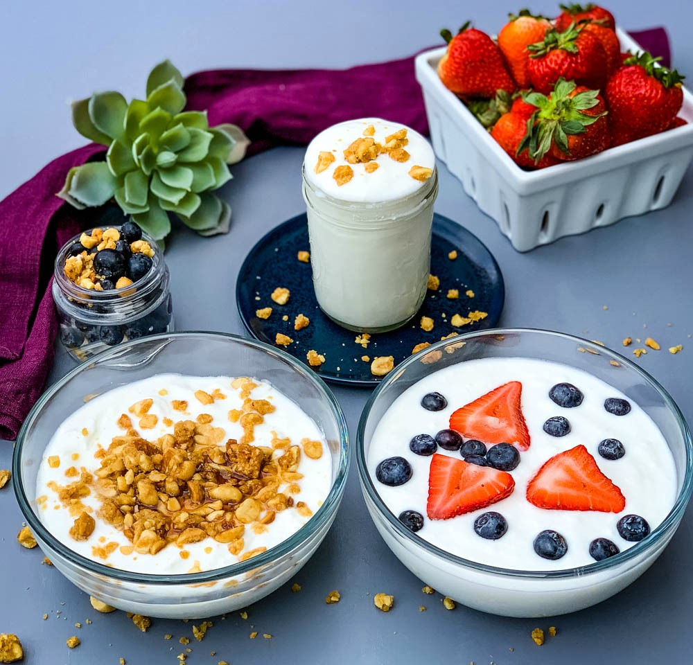 2 bowls of instant pot homemade yogurt with granola and fresh fruit