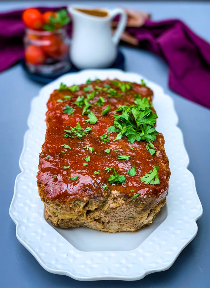 keto low carb meatloaf on a white serving plate