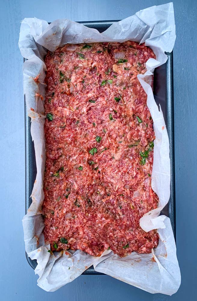 raw keto low carb meatloaf in a loaf pan