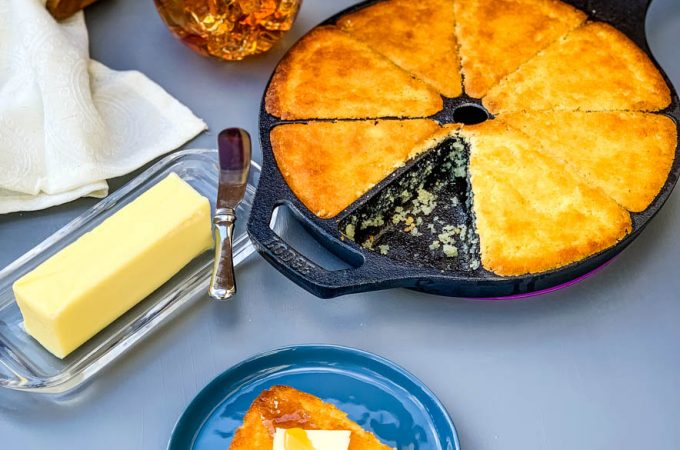 southern cast iron skillet cornbread on a plate and in a wedge pan with butter