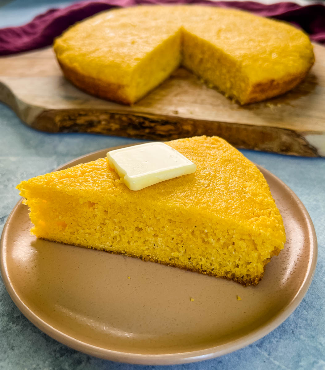overhead shot of cornbread in a cast iron skillet and southern cornbread on a plate
