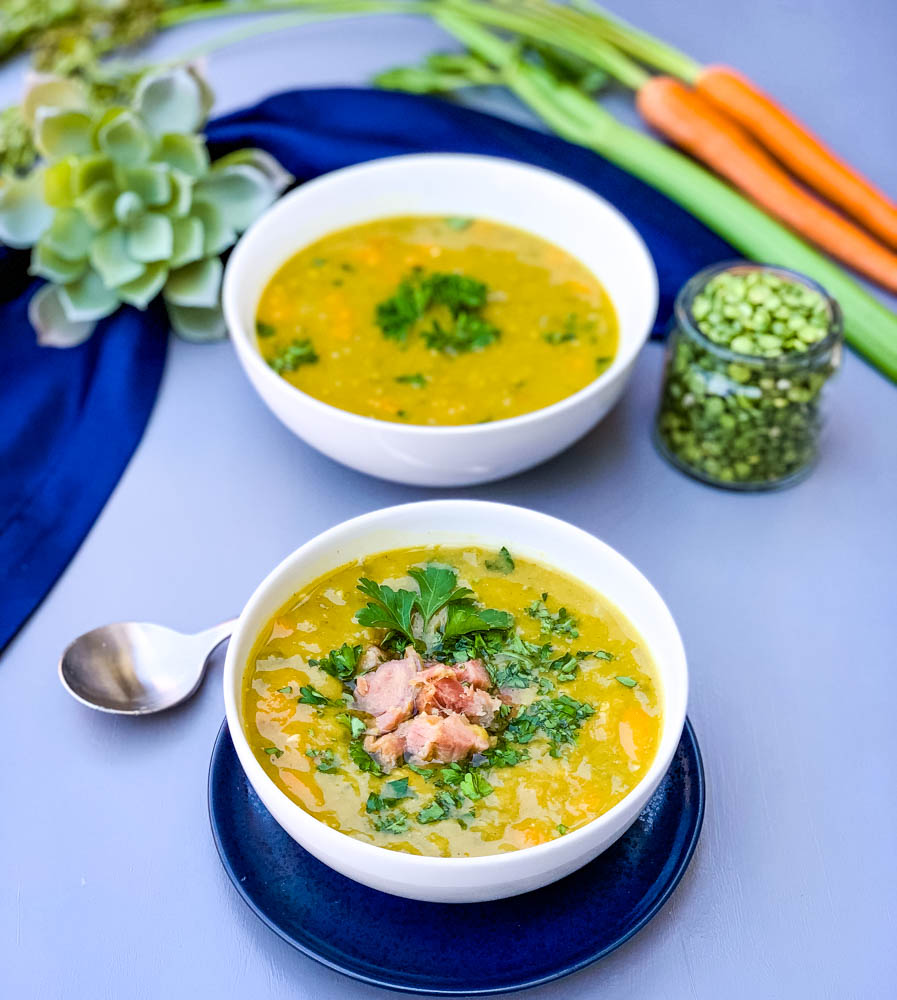 instant pot split pea soup in a white bowl on a blue plate
