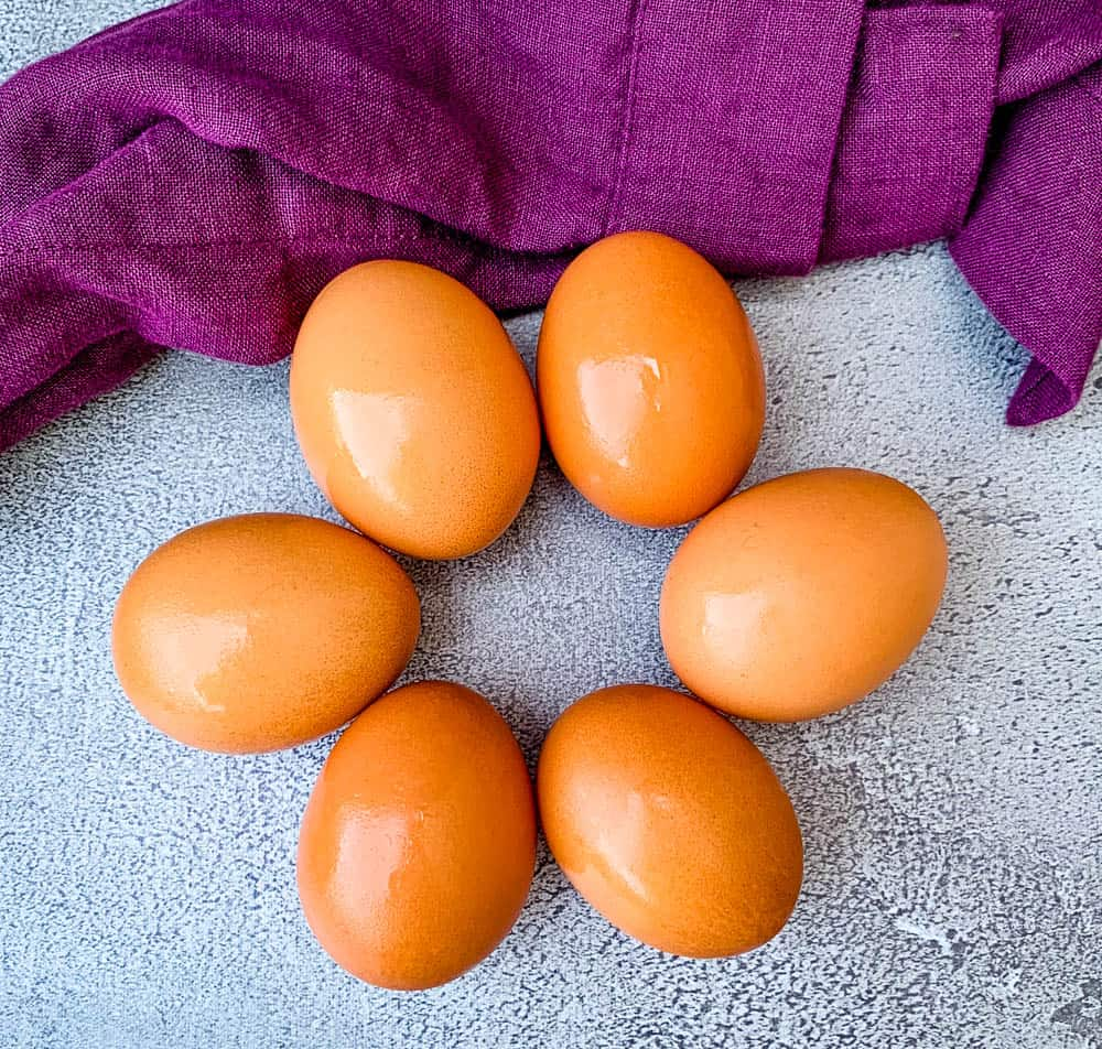 cage free brown eggs on a flat surface