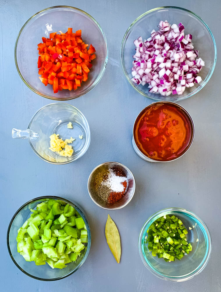 chopped red peppers, chopped onions, garlic, tomatoes, and celery in glass bowls