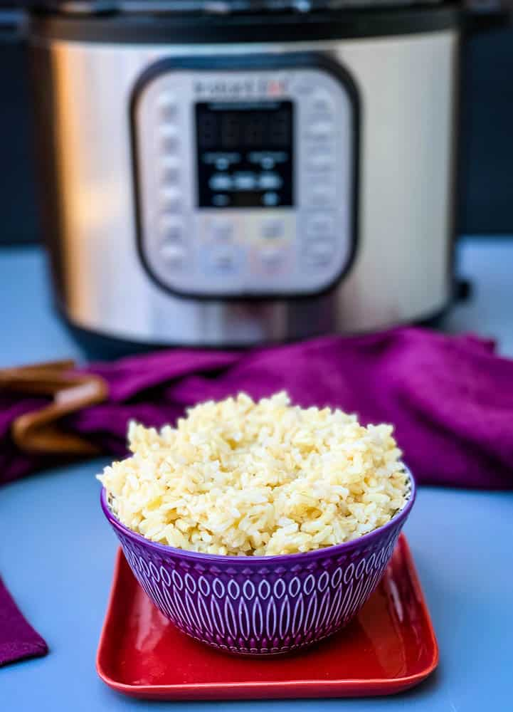 Instant Pot brown rice in a purple bowl