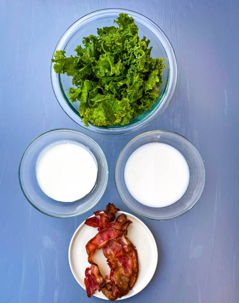 fresh kale, cooked bacon, heavy cream, and almond milk in separate bowls