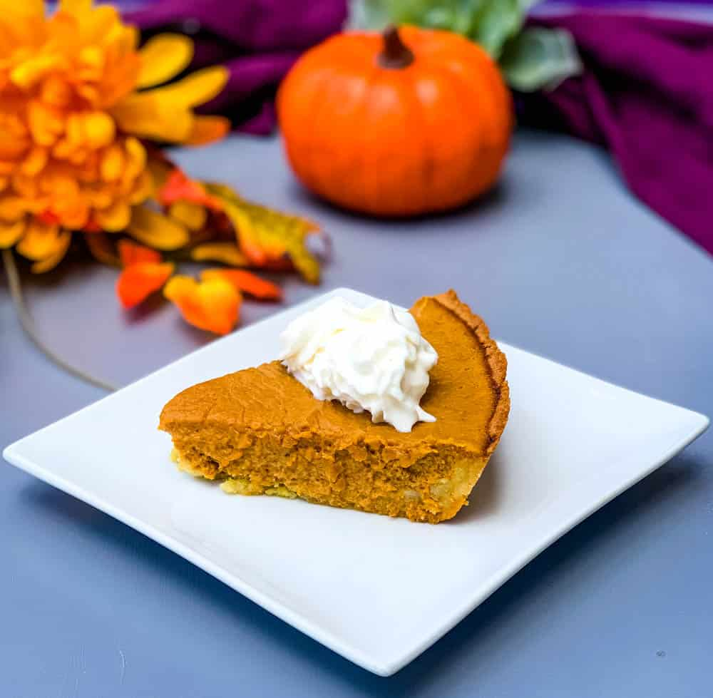 keto low carb pumpkin pie on a white plate with a