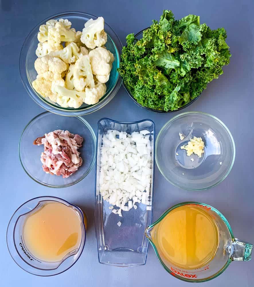 fresh cauliflower, fresh kale, uncooked bacon, chopped onions, garlic, and chicken broth