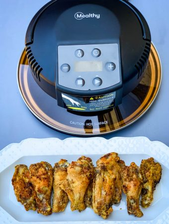 Mealthy crisp lid and air fryer chicken wings on a white plate